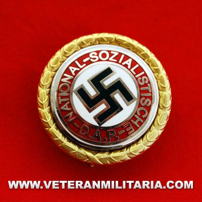 Distintivo del partido Oro